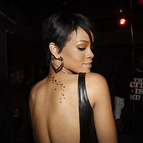 Rihanna showing her New Star Tattoo