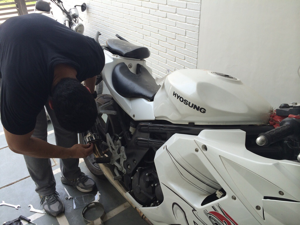 Guradesh and Varun installing two brothers carbon fibre exhaust